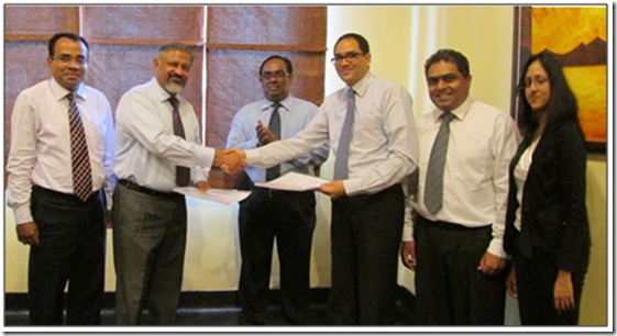 Signing of the agreement between John Keells Research (JKR) and the Human Genetics Unit (HGU) of the Faculty of Medicine, University of Colombo on 5 May 2014: The picture shows the exchange of the agreement between Prof. Rohan W Jayasekara (Former Dean, Faculty of Medicine and Former Director, Human Genetics Unit, Faculty of Medicine, University of Colombo) and Mr. Gihan Cooray (Head of Corporate Finance and Strategy and Executive Vice President, John Keells Group). In the picture from left to right are: Prof. Vajira H. W. Dissanayake (Professor and Medical Geneticist, Human Genetics Unit, Faculty of Medicine, University of Colombo); Prof. Rohan W Jayasekara; Dr. Sunil Jayantha Nawaratne, (Former Secretary, Ministry of Higher Education); Mr. Gihan Cooray; Dr. Muditha Senarath Yapa (Head, John Keells Research); and Ms. Madushani Kannangara (R & D Scientist – Molecular Life Sciences, John Keells Research).