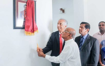 Unveiling a photograph of Dr. Siva Chinnatamby
